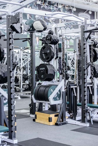 Expanded storage for bars, plyo boxes, medicine balls, and weight plates on the Pendulum Dual Rack XL