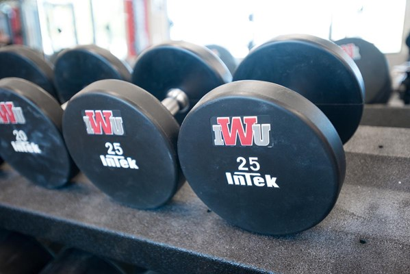 Custom InTek dumbbells were provided by Rogers.