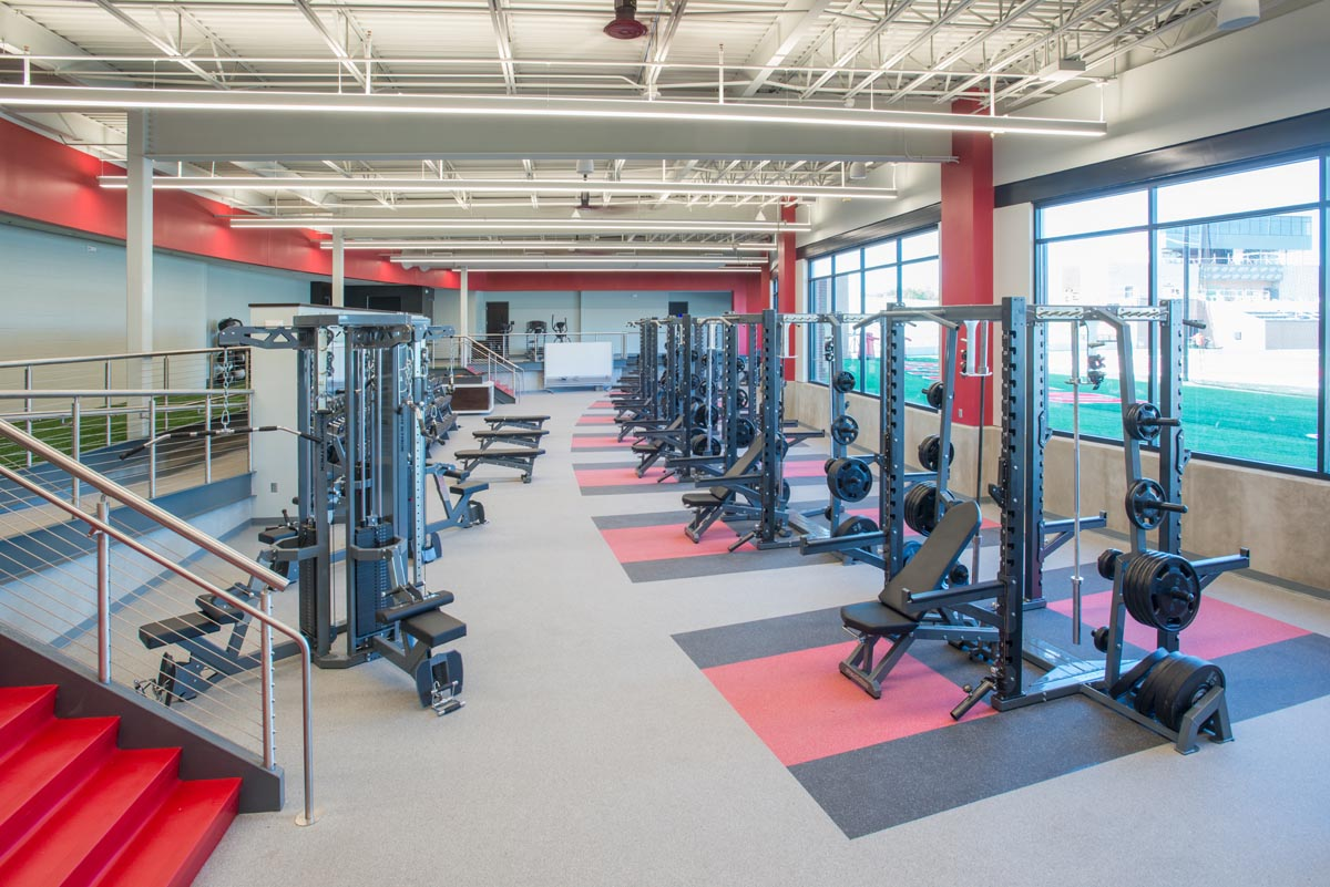 The Indiana Wesleyan University Weight room featuring Pendulum Dual Racks, Machines, Power Stacks, and Dumbbell Racks.